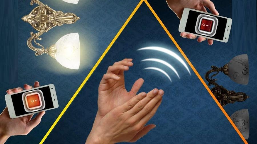 хлопок, телефон в руке, светильники